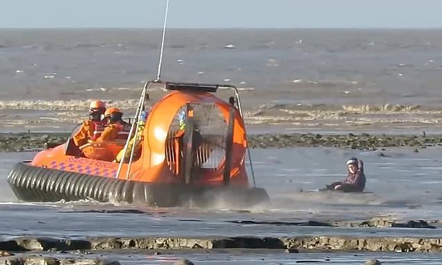 Seven-year-old boy is rescued by hovercraft after getting